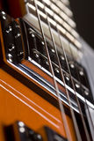 Orange electrical guitar. Close up of an orange electrical guitar Stock Photo