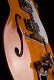 Orange electrical guitar Stock Photo