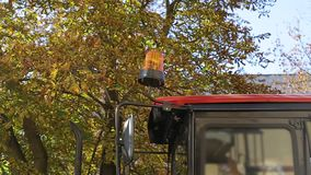 Orange emergency flasher on an excavator. The concept of attracting the attention of road users during work. Drivers