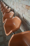 Orange empty Plastic Chairs Stock Photo