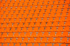Orange empty stadium seats Stock Photos