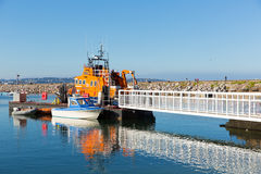 Orange English RNLI Lifeboat moored in Brixham Devon Stock Photos