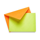 Orange envelope with green card Stock Photography