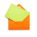 Orange envelope with green card Royalty Free Stock Photos