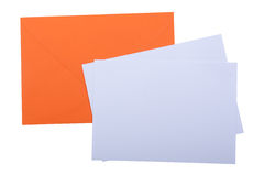 Orange envelope with white papers Royalty Free Stock Photography