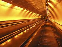 Orange Escalator. Escalator to subway station under neon lights Royalty Free Stock Images