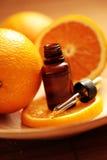 Orange essential oil Stock Photos