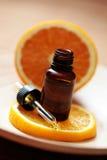 Orange essential oil Stock Image