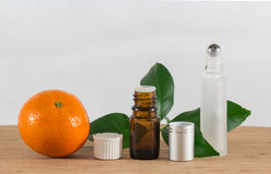 Orange Essential Oil Bottle With White Cap, Citrus Leaves and Roller Bottle Stock Images