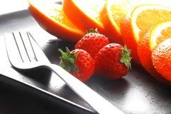Orange et fraises Photo stock