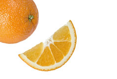Orange et tranche entières sur un blanc Photo stock
