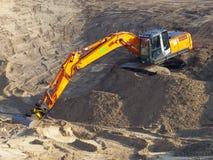 Orange excavator Royalty Free Stock Image