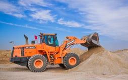 Orange Excavator on Brown Hill royalty free stock image