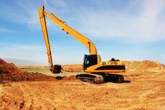 Orange excavator at construction site. Orange excavator at construction desert irrigation canal Royalty Free Stock Photography