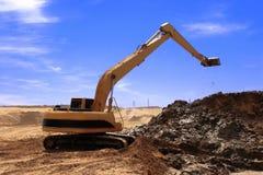 Orange excavator  at Construction site. Orange excavator  at Construction irrigation canal in Desert Stock Images