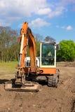 Orange excavator on a construction site Stock Image