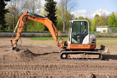 Orange excavator on a construction site Royalty Free Stock Photography