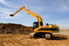 Orange excavator at construction site Stock Image