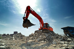 Orange Excavator excavating Royalty Free Stock Image