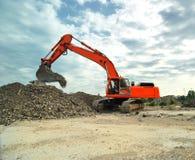 Crawler excavator on construction site. Big crawler excavator working on construction site Stock Images
