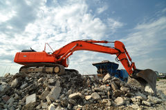 Demolition construction site activity. Lateral view of a big crawler excavator working on demolition construction site Royalty Free Stock Photography
