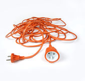 Orange extension cord. On white background stock photography