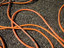 The Orange Extension Cord on the Ground at the Construction site Stock Images