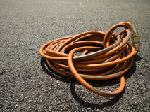 The Orange Extension Cord on the Ground at the Construction site Stock Photography