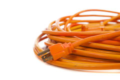 An orange extension cord on white Stock Photos