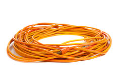 An orange extension cord on white Royalty Free Stock Photo