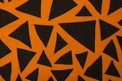Orange färg för linne med svarta trianglar Arkivbilder