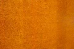 Orange färgbakgrund Arkivfoto