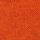 Orange fabric. Orange rough dirty linen striped  textured fabric Stock Photography