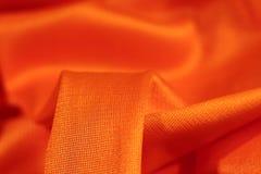 Orange fabric closeup Royalty Free Stock Image