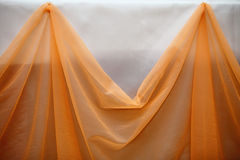 Orange fabric cloth and white wall decor detail Royalty Free Stock Photos