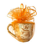 Orange fabric with cup. Close up cup was wrapped orange fabric with ribbon isolated Stock Photo