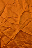 Orange fabric texture with creases. Stock Image