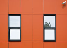 Orange facade of aluminum panels. Stock Images