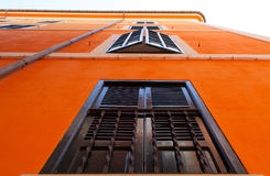 Orange facade with black windows Stock Photos