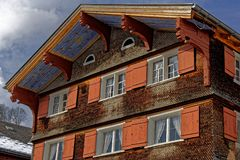 Orange facade of shingle house decorative architecture royalty free stock image