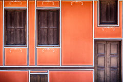 Orange Facade with Wooden Windows Stock Photography