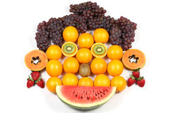 Orange Face. Arrangement of fruits, representing a stylized human face Royalty Free Stock Images