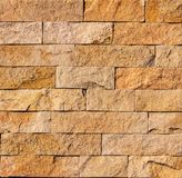 Orange facing stone, slate, sandstone and travertine marble texture. Backround royalty free stock images