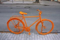 Orange Fahrrad Lizenzfreie Stockbilder