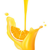 Orange falling into splash of juice. Royalty Free Stock Photos