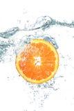 Orange falling in water Stock Image
