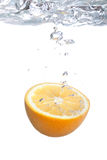 Orange falls into water Royalty Free Stock Photography