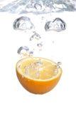 Orange falls into water Royalty Free Stock Photo