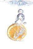 Orange falls into water Stock Image