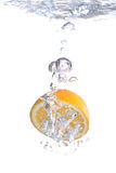 Orange falls into water Stock Photography